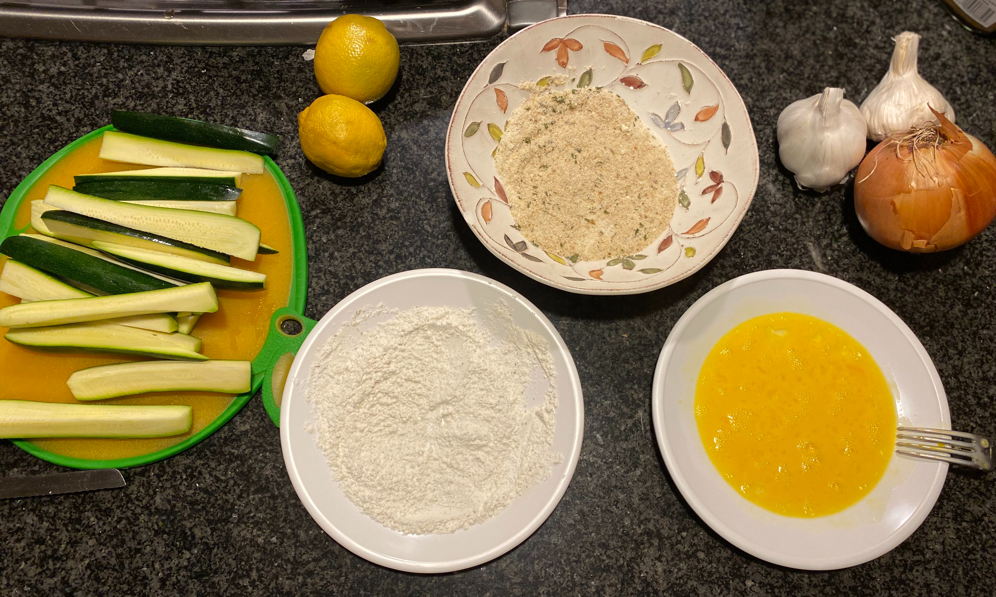 Make sure you have stations ready for your fries: a plate for flour, a plate for eggs, and one for breadcrumbs.