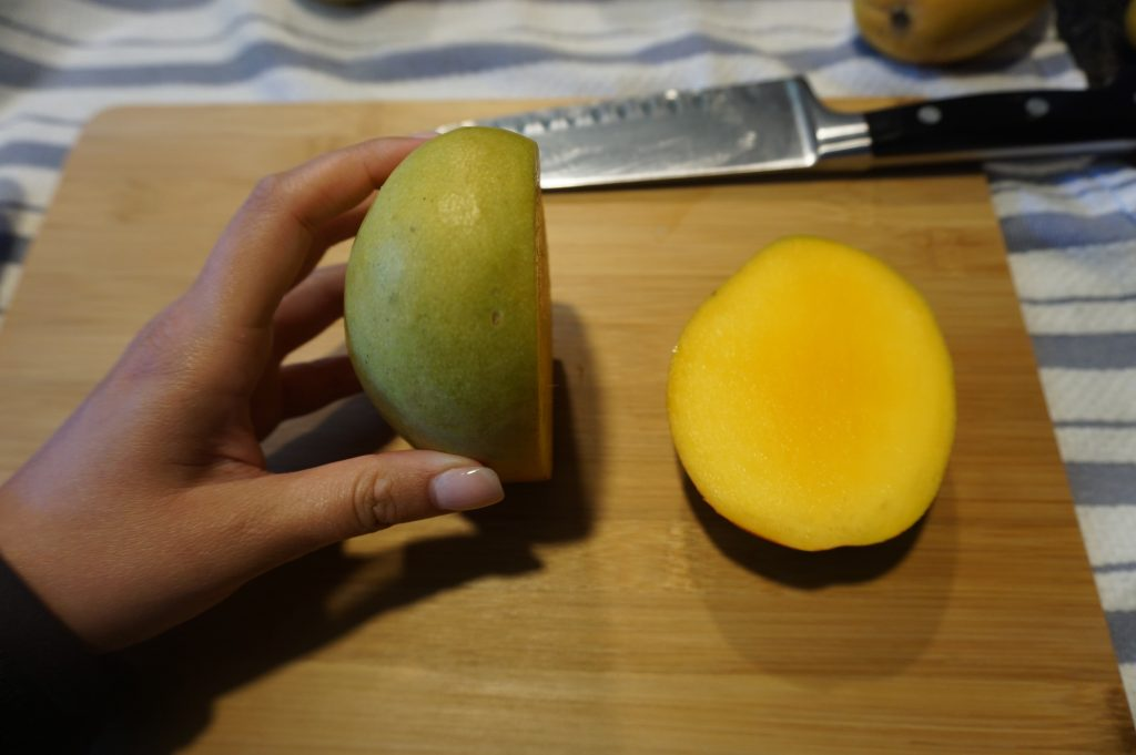 """Cut off the """"cheeks"""" of the mango first."""