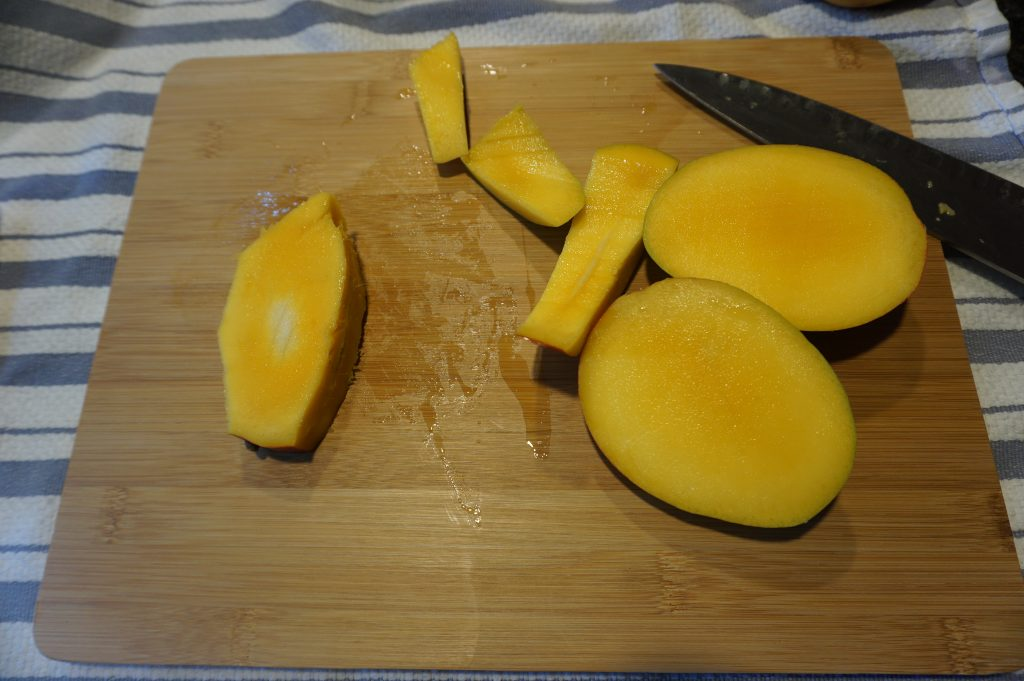 Cutting all sides off your mango