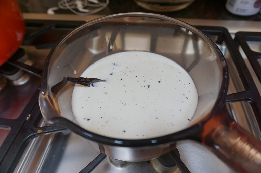The vanilla bean needs to be added directly to the cream when making the vanilla bean creme brulee.