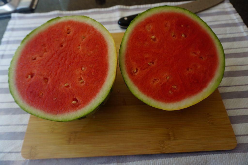 Cut the watermelon in half.