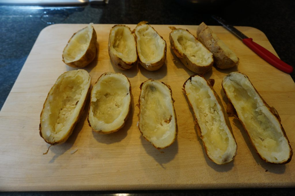 Hollowing out the potatoes is a critical step for potato skins.