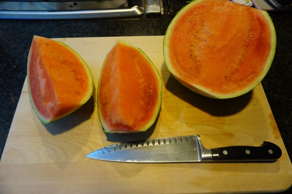 Make a vertical cut to turn the fruit into fourths.