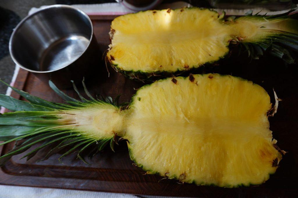 Split your pineapple in half. This is the shape your pineapple bowl ill take.