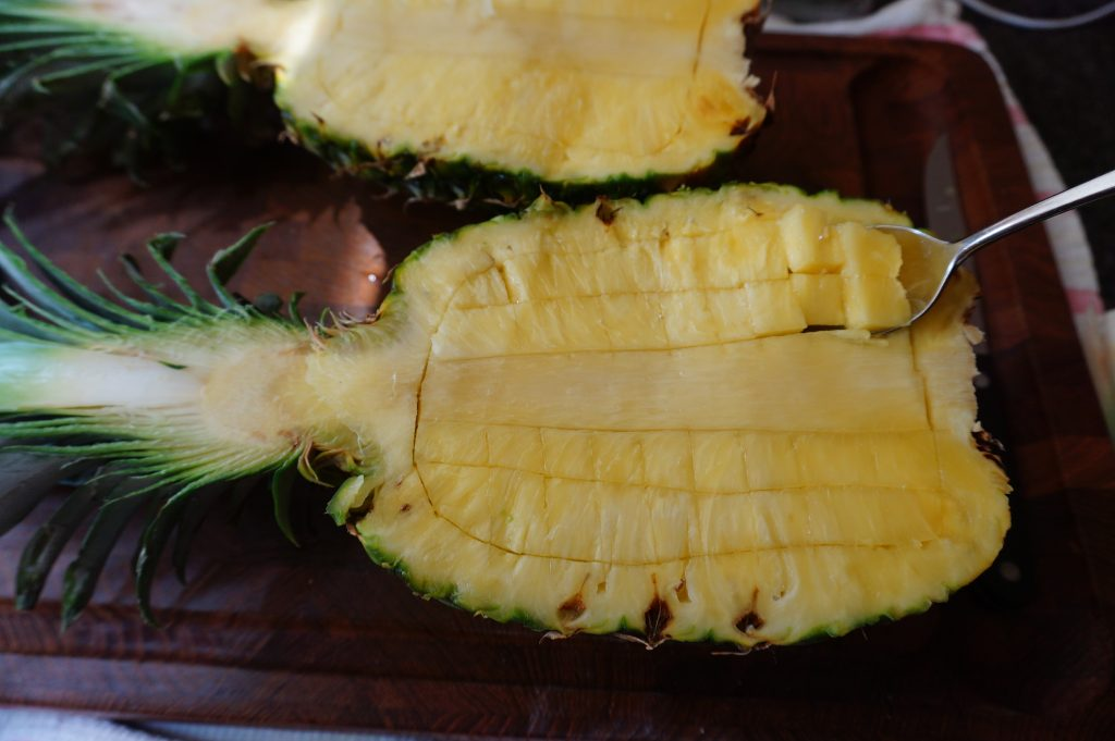 Score the flesh of the pineapple.